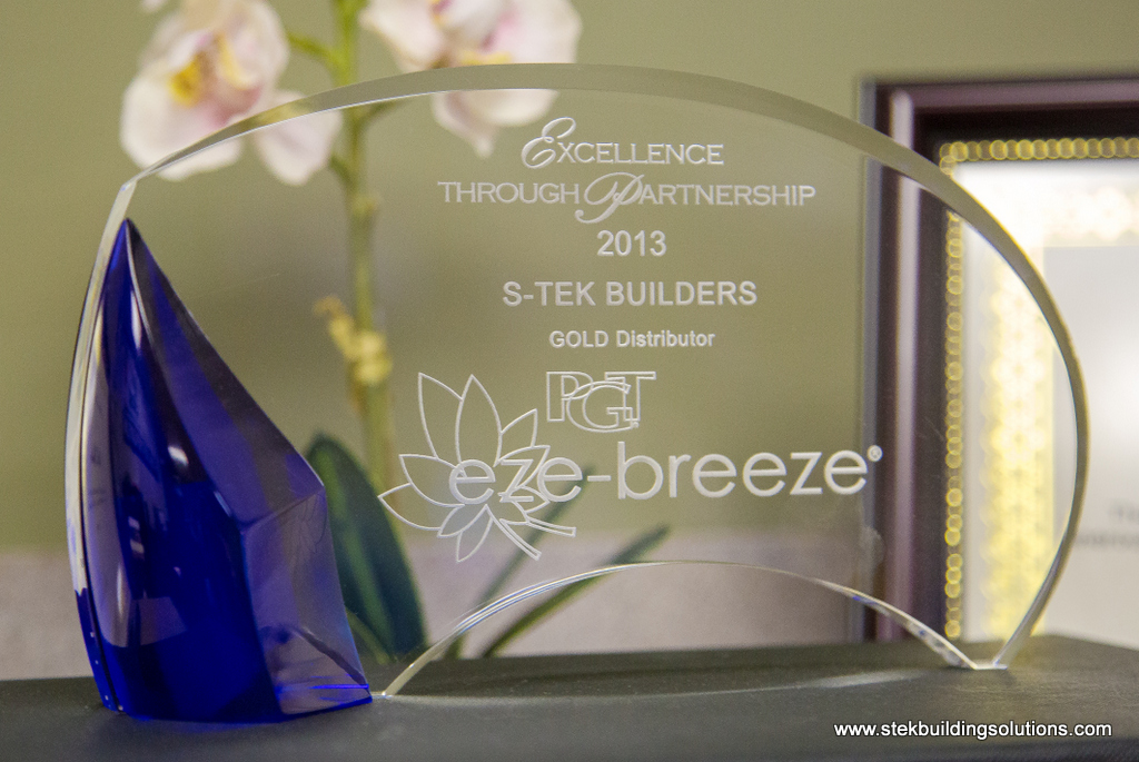 image shows Gold Award from PGT Eze Breeze windows on Porch Conversion of Seneca website